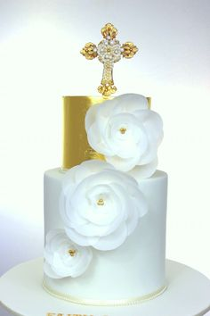 Gold leaf christening cake with wafer paper flowers