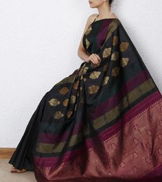 Black Kanjivaram Silk saree with Zari Work. Shop Now @ http://www.indianroots.in/black-kanjivaram-saree-with-zari-work