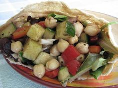 I make up this chickpea salad and keep it in the fridge for lunches all week long - store the extra cukes and red peppers covered in water and snack on them during the week too. Takes just a few minutes to prepare and keeps very well in a tightly sealed container.  Also, good topped with feta and tomatoes just before serving.