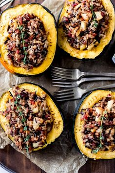 A delicious stuffed acorn squash recipe made with wild rice, pancetta, apples, and herbs. #acornsquash #fallrecipes #stuffedsquash #stuffedacornsquash #comfortfood
