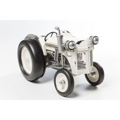 Bring a rustic touch to your decor with this detailed decorative tractor figurine, handsomely crafted with high-quality materials for an eye-catching interior addition. Decorative Items, Decorative Accessories, Old World, Tractors, Antique Cars, Rustic, Steel, Interior, Crafts