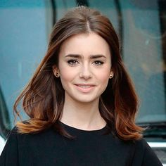 Lily Collins with subtle bouffant hairstyle - Medium Length Hairstyles