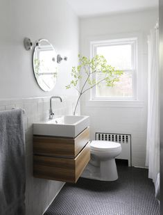 Ore Studios Cape Cod modern - good budget design with Ikea vanity and light bulb sconces. Love the floating vanity. Ikea Bathroom Vanity, Bathroom Renos, Laundry In Bathroom, Modern Bathroom, Master Bathroom, Compact Bathroom, Modern Toilet, Cute Shower Curtains, Basement Inspiration