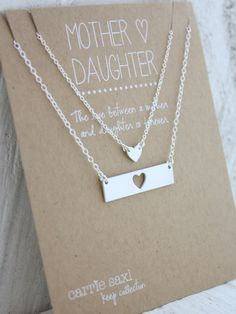 Mother and Daughter necklace set. A hand-cut sterling silver heart  silhouette pendant for mom and silver heart charm necklace for daughter.  These handmade keepsakes make a perfect gift for mother and daughter and  will last a lifetime. Necklaces are presented on a custom MOTHER DAUGHTER  quote