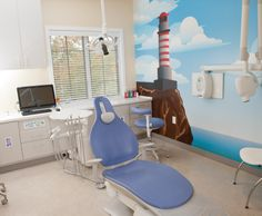 Private treatment room in pediatric dental office with wall mural.