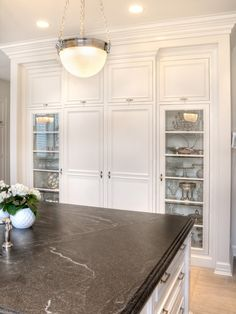 Granite countertops:  Color: Jet Mist or called Virginian Mist (dark gray with white swirls), not absolute black. Finish is leathered or called honed.