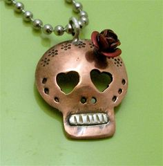 Coqueta,  Copper Day of the Dead Skull with Red Rose. $35.00, via Etsy.