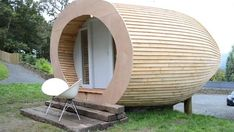 the Glam Pod in the UK, can be connected to utilities and water and is made out of 95% timber with English cedar as the exterior siding