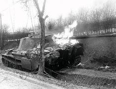 """A burning German Panther tank from the SS Panzer Division """"Hitlerjugend"""", destroyed by American troops near Krinkelt, Belgium. A German crew member is taken away by a sergeant from the Photo Company Willys Mb, Sherman Tank, Tiger Ii, Panzer Iv, Tiger Tank, Ardennes, Battle Tank, Princesas Disney, War Machine"""