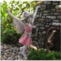 "Fairy Lexi - $9.00  Lexi is frolicking through the field on a sunny day. Her hat keeps the sun off her face as she throws her arms into the air. She is 3.5"" tall on a stake in her bare foot."
