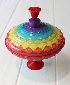 rainbow humming spinning top by posh totty designs interiors | notonthehighstreet.com Babies do always love these!