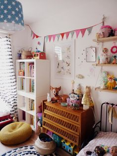 J'aurais pu m'appeler Marcel...vintage retro kids room with colorful flag bunting, tumble doll, Woodland doll, Heico lamps and toy piano, and soft toys by Lucky Boy Sunday.