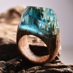 Vancouver-based Secret Wood makes handcrafted wooden rings that capture miniature worlds within transparent resin. Wood Resin, Resin Art, Ring Ring, Secret Wood Rings, Resin Jewelry, Unique Jewelry, Hand Jewelry, Do It Yourself Jewelry, Unusual Rings
