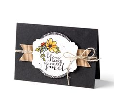 My Heart Smiles Card | Stamps • Timeless Love Stamp Set; Paper: • Basic Black and Shimmery White, • Everyday Chic DSP, • Kraft and White Corrugated Paper; Ink: • Cajun Craze, Hello Honey, Mint Macaron, Mossy Meadow and Old Olive Classic Stampin' Ink® Refills; Accessories: • Clear Stampin' Emboss® Powder, • Linen Thread, • Stampin' Dimensionals®, • Aqua Painters®, • Blender Pens, • Banner Triple Punch, • Big Shot™, • Deco Labels Collection Framelits™