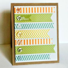 nice arrangement of washi tape banner cuts or left over scrap paper, anchored with buttons...