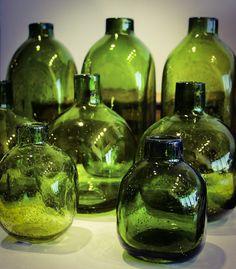 Seven Green Glass Bottles .