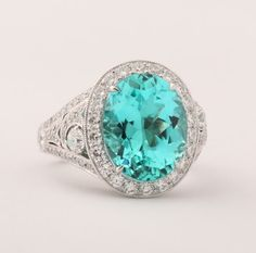 one of a kind custom set paraiba tourmaline ring.... My new favorite gem stone