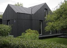 This charcoal stained, timber clad home in the seaside town of Jurmula in Latvia, is the perfect example of a modern renovation meeting old world charm. What looks and feels like a time worn but mo… Bruges, Clad Home, House Cladding, Black House Exterior, Timber Buildings, Black Barn, Modern Farmhouse Exterior, Residential Architecture, House Architecture