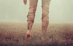 I'm running from something, but I can't run. There's barbed wire wrapped around each of my legs.