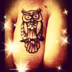 New owl tattoo on middle finger