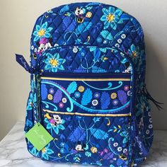 """Shop Women's Vera Bradley Blue Yellow size OS Backpacks at a discounted price at Poshmark. Description: LIMITED EDITIONBrand new, 100% authentic! Color: dreaming mickey. Dimensions: 16'' H x 13'' W x 6'' D with 2 ¾"""" handle drop and 28 ½"""" adjustable shoulder straps with quilted exterior. Two main compartments with double zip closure, phone pocket, accessory pocket, and 2 penholders in large compartment. Tp carrying handle, 2 adjustable shoulder straps,... Vera Bradley Disney, Travel Items, School Backpacks, Vera Bradley Backpack, Business Logo, Vacation Trips, Shoulder Straps, Blue Yellow, Cosmetic Bag"""