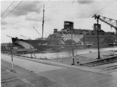 USS Europa moored at Bremerhaven in May 1945.jpg