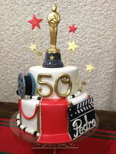 """Over the Hill - Twoe tier Vanila cake covered with fondant and gumpaste accents. The ¨""""Oscar"""" was provided by the client. Had a lot of fun making this cake ;)"""