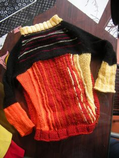 Wool sweater multicolor for my kid,Orange / yellow / dark red.Front side.Handmade knitting by Barlume Manod'opera.