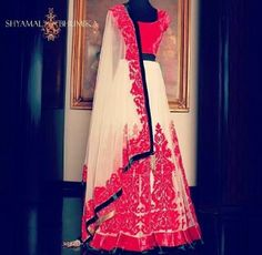 White and red designer lehenga choli For more collection visit our website www.panachehautecouture.co.in