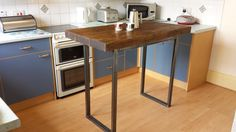 kitchen prep table with wooden floor