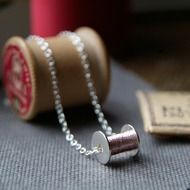 Bobbin Necklace - Handmade in Sterling Silver Reel measures 14mm x 12mm Chain is 45cm in length (just add a note order if you'd like a little longer or shorter) It comes with REAL sewing thread!! Use it to darn your stockings (emergency only)! PLEAS...