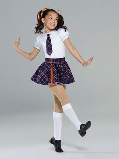 NEW! 2017 Collection Character Costumes: Spandex leotard with sequin front and puff sleeves is fully-lined with keyhole back detail, attached plaid tie, and extended bike-shorts leg line. Attached skirt has layers of organdy under plaid skirt with faux buttons and spandex pleat.  Includes hair bows, socks, hanger and garment bag.