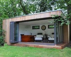 Wide bi-folding doors create a vast open space in this garden lodge Outdoor Office, Backyard Office, Backyard Studio, Garden Office, Outdoor Rooms, Garden Lodge, Garden Cabins, Summer House Garden, Casas Containers