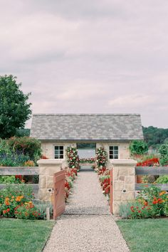A lush garden and patio overlooking a lake. Photo: @blainesiesser Home Wedding, Garden Wedding, Wedding Ceremony, Wedding Ideas, Air Tent, Red And White Flowers, Red Colour Palette, Martha Stewart Weddings, Lush Garden
