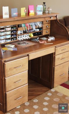 """The Stamp-n-Storage Roll-Top Desk, made of solid wood, is specially designed to store your 8.5""""x11"""" and 12""""x12"""" paper, punches, ink pads, markers, and ribbons. When you're not using it, just close the roll-top! This desk is perfect for any paper crafter who needs a little space to create and an easy way to keep their supplies organized!"""