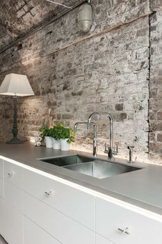 White brick backsplash for kitchen. Paint coat to appear more industrial ? Industrial light also nice White brick backsplash for kitchen. Paint coat to appear more indust White Brick Backsplash, White Brick Walls, Exposed Brick Walls, Kitchen Backsplash, Backsplash Ideas, Grey Walls, Paint Backsplash, Kitchen Countertops, Kitchen Sinks