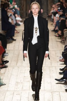Valentino Fall 2016 Couture Fashion Show - Natalie Ludwig - I love that the tie details on the shirt are carried into the jacket as well. This silhouette is reminiscent of 19th century menswear looks, which is in line with the trend toward Victorian-era neck lines and sleeves. This outfit is also an example of the trend towardblack and white pairings on the runway.