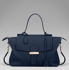 The Berkeley handbag in soft navy calf leather with contrasting suede interior and swing lock closure. #SmythsonAW14 http://www.smythson.com/navy-berkeley-handbag.html