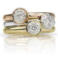 These beautiful diamond stacking rings feature 0.16 tcwt diamonds in 14K rose gold, 14K white gold and 14K yellow gold.