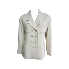 CHANEL Creme Wool Blaser with Double Pocket Detail and Gold Logo Buttons   From a collection of rare vintage jackets at https://www.1stdibs.com/fashion/clothing/jackets/
