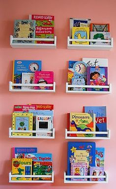 Ikea Spice Racks: Use spice racks from Ikea to create a wall of storage for your kids favorite books! Who knew there was a better use for spice racks than storing spices? Learn more about this project over at Ikea Hacks.