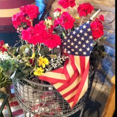 Potted geraniums accented with a flag.  Great for summer decorating.