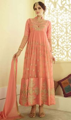 Astound with a bewildering and elusive beauty in with this salmon color georgette and net anarkali churidar suit. The stunning lace and resham work a intensive characteristic of this attire. #gorgeouslookanarkali #stuninnganarkalidress #georgetteanarkalisuits