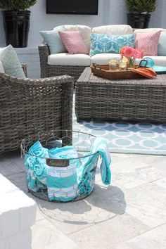 Wire baskets from HomeGoods are great for storage. In this case, towels by the pool.