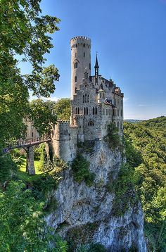 "Germany: near Honau on the Swabian Alb, Baden-Württemberg. Lichtenstein Castle, built in the 19th century. Inspired by Wilhelm Hauff's novel ""Lichtenstein"" Count Wilhelm of Württemberg had it built in 1840-42. The site around the neo-Gothic castle is composed of other buildings from the 19th century, a chapel, an ample garden and the romantic courtyard. In the bedchambers of the count the opulent grandeur of late romanticism's domestic culture appears at its best."