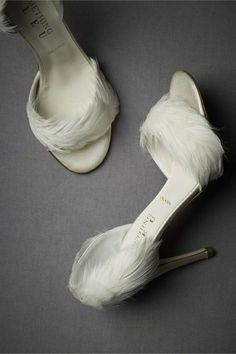 DIY feather Shoes,all you need is a steady hand and a hot glue gun.