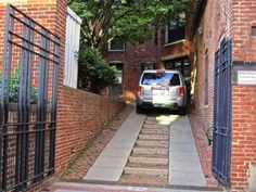 Steep driveway with nature steps beside making the for Cost of building on a steep slope