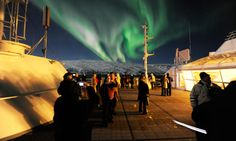 Watch the Aurora Boraelis from the Hurtigruten Cruise. http://www.secretearth.com/attractions/884-the-hurtigruten-cruise