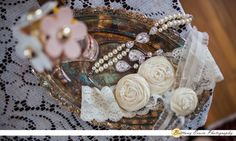 Ambassador House wedding ceremony and reception venue in Fishers Indiana | Detail photo of garter belt, etsy jewelry, earrings, bracelet and perfume on antique metal tray | (c) Brittany Erwin Photography