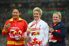 (L-R) Silver medalist Wenxiu Zhang of China, gold medalist Anita Wlodarczyk of Poland and bronze medalist Alexandra Tavernier of France pose on the podium during the medal ceremony for the Women's Hammer final during day six of the 15th IAAF World Athletics Championships Beijing 2015 at Beijing National Stadium